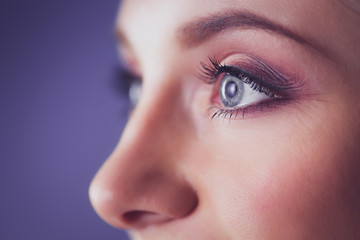 Foto op Plexiglas Beauty A beautiful woman, portrait isolated on blue background