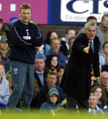 CHELSEA MANAGER RANIERI AND EVERTON MANAGER MOYES DIRECT THEIR TEAMS ATGOODISON PARK.