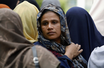 A woman waits to get into a polling station during the Shura elections in Zagazig