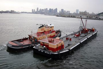 Oil barge is seen floating in Boston Harbor in Chelsea Massachusetts