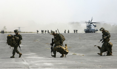U.S. troops arrive at the Basa airforce headquarters in Pampanga province, north of Manila