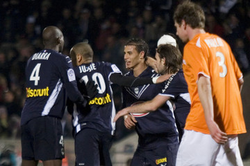 Chamakh of Girondins Bordeaux is congratulated by teammates after he scored during the French Ligue 1 soccer match against Grenoble at the Chaban Delmas stadium in Bordeaux