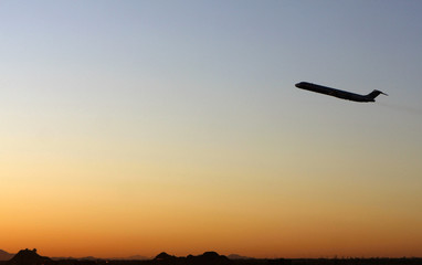 A Northwest Airlines airplane departs Sky Harbor International Airport in Phoenix