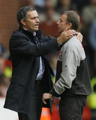 Chelsea's manager Mourinho hugs the fourth official during their English Premier League match against Sheffield United in Sheffield