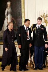 Muhammad Ali is escorted into East Room for Medal of Freedom ceremony