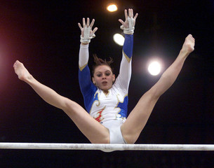 Alexandra Soler of France in action during the Asymetric Bars event in the team competition and indi..