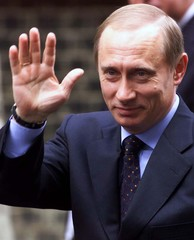 Russian President-elect Vladimir Putin waves as he arrives at No 10 Downing Street in London for a m..