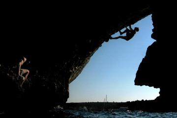 Rial of Spain practices Psicobloc climbing over Mediterranean sea in Mallorca