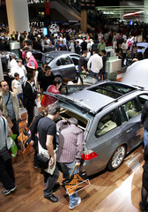 Thousands of visitors look at cars on display at the Paris Mondial de l'Automobile.
