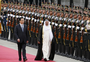 China's President Hu Jintao and Kuwait's Emir Sheikh Sabah al-Ahmad al-Sabah inspect honour guard outside Great Hall of the People in Beijing