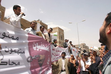 Journalists and rights activists take part in a protest demanding more press freedom in Sanaa