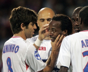 Juninho, Cris, Govou and Diarra of Olympique Lyon celebrate after scoring against Lens during their French Ligue 1 soccer match