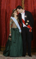 Crown Prince Felipe talks to Princess Letizia as they pose before a gala dinner at Madrid's Royal Palace
