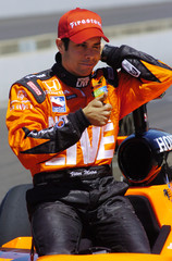 Vitor Meira gestures after qualifying for the 90th Indianapolis 500
