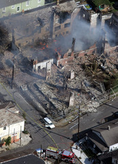 Fires burn destroying buildings near downtown New Orleans.