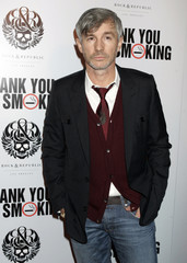 """Australian director Luhrmann poses at the Los Angeles premiere of the film """"Thank You for Smoking\"""