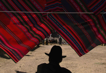 An indigenous man attends the South America's indigenous Aymara cultural gathering at the Quimsa Chata hill