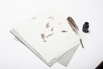 A fountain pen with ink, letter on the white table.