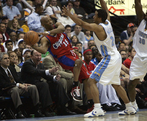 Clippers Cassell pushed out of bounds by Nuggets Miller  in Denver