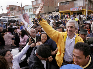 Polo Democratico Party's candidate for mayor of Bogota Moreno greets supporters before casting his vote in Bogota