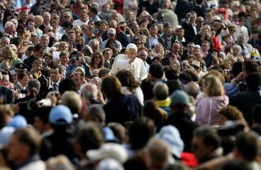 Pope Benedict XVI arrives to lead his weekly Wednesday general audience in St Peter Square at the Vatican