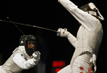 Vezzali of Italy competes against Zhang Lei of China during their women's individual foil fencing competition at the Beijing 2008 Olympic Games