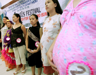 """Pregnant Filipino women parade during a 'Most beautiful pregnant mother"""" in Manila."""