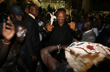 Reverend Jackson of the U.S. dances after arriving at Felix Houphouet Boigny international airport in Abidjan