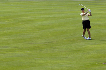 Karrie Webb watches her approach shot to the 15th hole during the first round of the Women's Golf Masters in Evian
