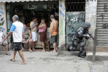 Police patrol the Jacarezinho slum in Rio