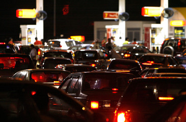 Motorists line up to buy petrol before the price increase at midnight, in Putrajaya