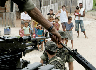 Brazilian soldiers patrol Anapu near where American nun Stang was assassinated.