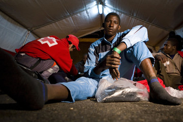 A would-be immigrant rests inside a Red Cross tent upon arriving at Arguineguin port