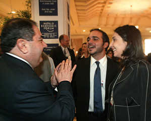 Iraqi Foreign Minister Zebari speaks with Jordan's Prince Ali and Princess Rym during the World ...
