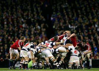 The British and Irish Lions and Auckland forward packs form a scrum during their tour match in ...