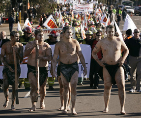 Aboriginal dancers lead workers on a march through Blacktown during protest over government's Industrial Relations laws in Sydney