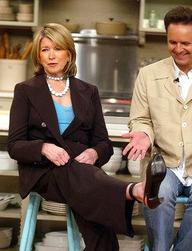 Martha Stewart shows her electronic monitoring bracelet as producer Mark Burnett looks on during news ...