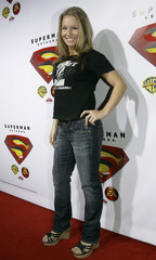 """Actress Orr poses for photographs during """"Superman Returns"""" DVD and video game launch party in Hollywood"""
