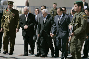 Palestinian President Abbas is surrounded by officials and bodyguards during a funeral ceremony for an official in his office in Ramallah