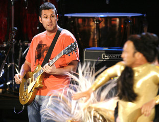 Actor Sandler performs as actor Schneider dances on stage at 2008 MTV Movie Awards in Los Angeles