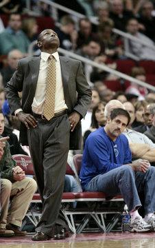 Dallas Mavericks head coach Johnson looks to the scoreboard as team owner Cuban keeps his eye on the action