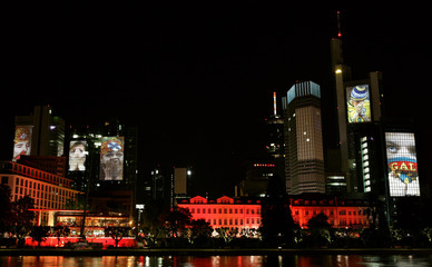 Huge photographs of soccer images are projected onto skyscrapers in downtown Frankfurt