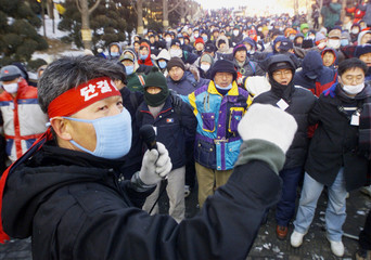 STRIKING WORKERS FROM SOUTH KOREA'S KOOKMIN BANK AND THE HOUSING AND COMMERCIAL BANK CHANT ...