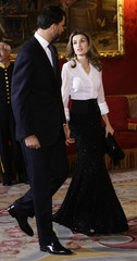 Spain's Crown Prince Felipe (L)and Spain's Princess Letizia talk before an official dinner with  Hungary's President Laszlo Solyom at Madrid's Royal Palace