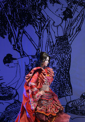 Model presents a creation at the China Fashion Week in Beijing