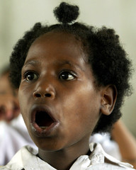 A first grade Papuan girl learns the alphabet during a Bahasa Indonesia lesson at the lowland town o..