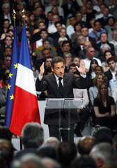France's President Sarkozy delivers a speech about the upcoming European Parliament elections during a rally in Nimes