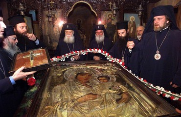 Bulgarian priests decorate with flowers Jerusalem's icon of the Virgin Mother and Baby Jesus in a ch..