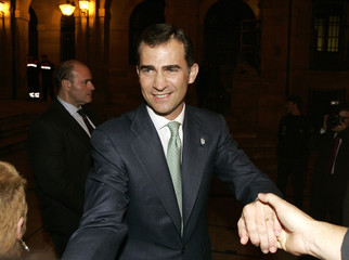 Spain's Prince Felipe greets crowd after a ceremony in Oviedo