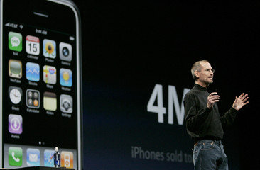 Apple CEO Steve Jobs announces the number of iPhones sold during the Macworld Convention and Expo in San Francisco